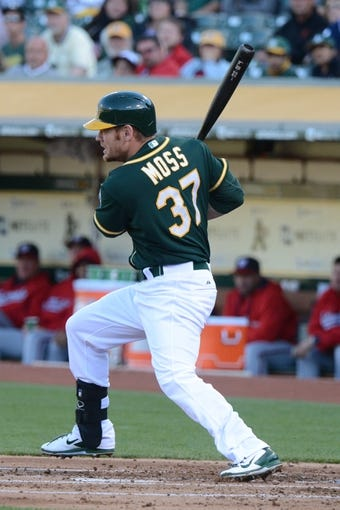 May 10, 2014; Oakland, CA, USA; Oakland Athletics first baseman Brandon Moss (37) bats against the Washington Nationals during the first inning at O.co Coliseum. The Athletics defeated the Nationals 4-3 in 10 innings. Mandatory Credit: Kyle Terada-USA TODAY Sports