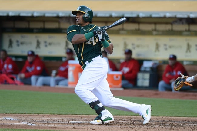 May 10, 2014; Oakland, CA, USA; Oakland Athletics left fielder Yoenis Cespedes (52) bats against the Washington Nationals during the second inning at O.co Coliseum. The Athletics defeated the Nationals 4-3 in 10 innings. Mandatory Credit: Kyle Terada-USA TODAY Sports