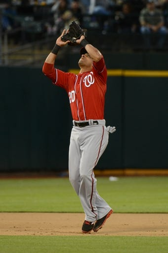 May 10, 2014; Oakland, CA, USA; Washington Nationals shortstop Ian Desmond (20) catches a pop fly during the eighth inning against the Oakland Athletics at O.co Coliseum. The Athletics defeated the Nationals 4-3 in 10 innings. Mandatory Credit: Kyle Terada-USA TODAY Sports