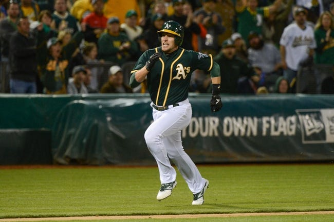 May 10, 2014; Oakland, CA, USA; Oakland Athletics shortstop Jed Lowrie (8) runs home against the Washington Nationals during the ninth inning at O.co Coliseum. The Athletics defeated the Nationals 4-3 in 10 innings. Mandatory Credit: Kyle Terada-USA TODAY Sports