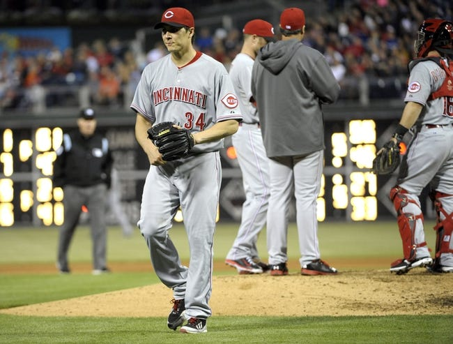 May 17, 2014; Philadelphia, PA, USA;  Cincinnati Reds starting pitcher Homer Bailey (34) walks to the dugout after being pulled from the game in the fourth inning against the Philadelphia Phillies at Citizens Bank Park. Mandatory Credit: Eric Hartline-USA TODAY Sports