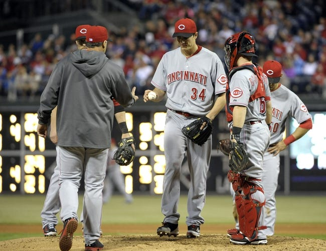 May 17, 2014; Philadelphia, PA, USA;  Cincinnati Reds starting pitcher Homer Bailey (34) hands the ball to  manager Bryan Price (38) in the fourth inning against the Philadelphia Phillies at Citizens Bank Park. Mandatory Credit: Eric Hartline-USA TODAY Sports