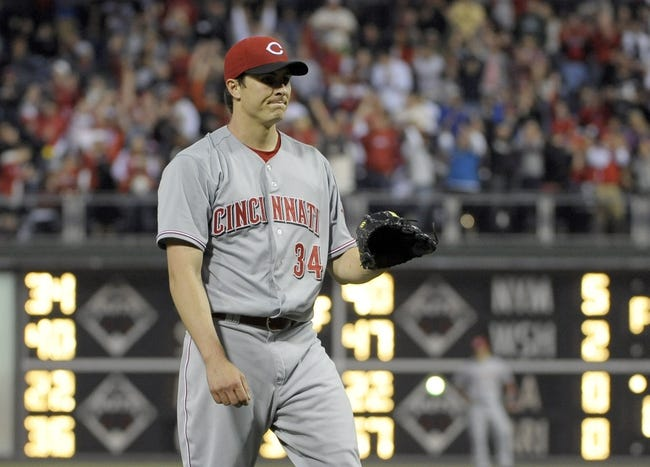 May 17, 2014; Philadelphia, PA, USA;  Cincinnati Reds starting pitcher Homer Bailey (34) reacts after allowing a home run to Philadelphia Phillies left fielder Domonic Brown (not pictured) in the fourth inning at Citizens Bank Park. Mandatory Credit: Eric Hartline-USA TODAY Sports