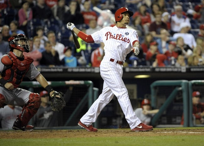 May 17, 2014; Philadelphia, PA, USA; Philadelphia Phillies second baseman Cesar Hernandez (16) watches his home run in the eighth inning against the Cincinnati Reds at Citizens Bank Park. The Phillies defeated the Reds, 12-1. Mandatory Credit: Eric Hartline-USA TODAY Sports