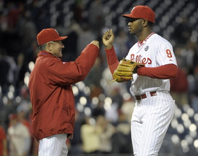 May 17, 2014; Philadelphia, PA, USA; Philadelphia Phillies bench coach Larry Bowa (10) and left fielder Domonic Brown (9) celebrate their win against the Cincinnati Reds at Citizens Bank Park. The Phillies defeated the Reds, 12-1. Mandatory Credit: Eric Hartline-USA TODAY Sports