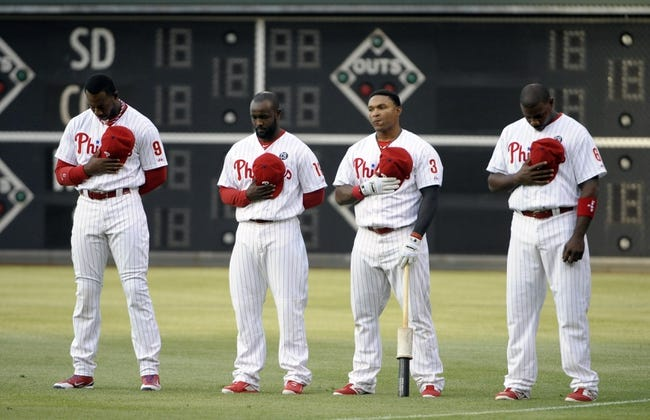 May 17, 2014; Philadelphia, PA, USA; Philadelphia Phillies left fielder Domonic Brown (9), center fielder Tony Gwynn (19), right fielder Marlon Byrd (3) and first baseman Ryan Howard (6) stand during the national anthem before a game against the Cincinnati Reds at Citizens Bank Park. The Phillies defeated the Reds, 12-1. Mandatory Credit: Eric Hartline-USA TODAY Sports