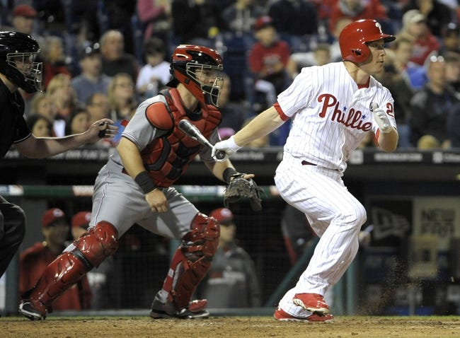 May 17, 2014; Philadelphia, PA, USA; Philadelphia Phillies third baseman Cody Asche (25) watches his RBI single against the Cincinnati Reds in the seventh inning at Citizens Bank Park. The Phillies defeated the Reds, 12-1. Mandatory Credit: Eric Hartline-USA TODAY Sports