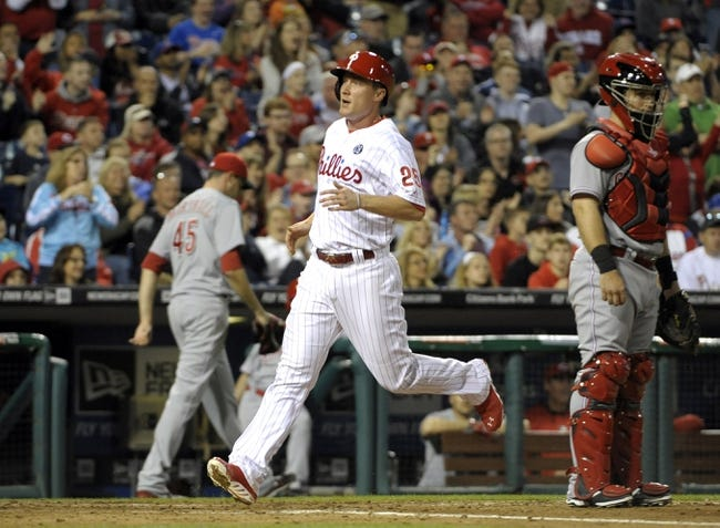 May 17, 2014; Philadelphia, PA, USA; Philadelphia Phillies third baseman Cody Asche (25) scores a run against the Cincinnati Reds in the seventh inning at Citizens Bank Park. The Phillies defeated the Reds, 12-1. Mandatory Credit: Eric Hartline-USA TODAY Sports