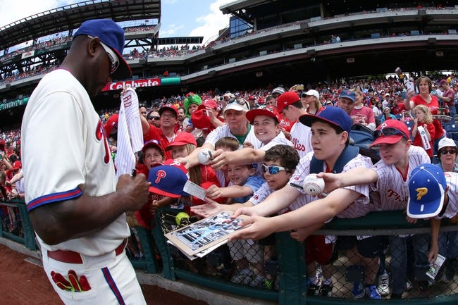 May 18, 2014; Philadelphia, PA, USA; Philadelphia Phillies first baseman Ryan Howard (6) signs autographs for the fans prior to a game against the Cincinnati Reds at Citizens Bank Park. The Phillies won 8-3. Mandatory Credit: Bill Streicher-USA TODAY Sports