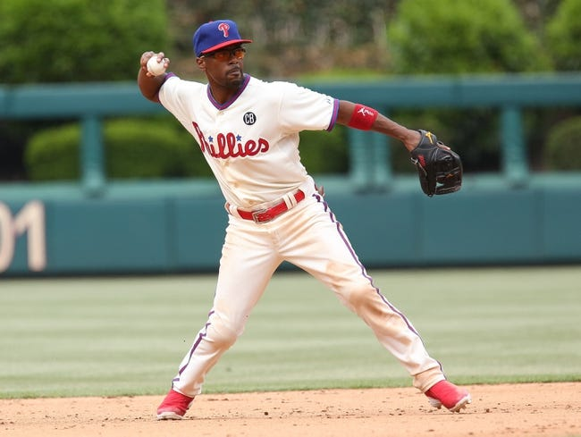 May 18, 2014; Philadelphia, PA, USA; Philadelphia Phillies shortstop Jimmy Rollins (11) throws to first in a game against the Cincinnati Reds at Citizens Bank Park. The Phillies won 8-3. Mandatory Credit: Bill Streicher-USA TODAY Sports