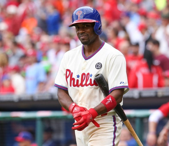 May 18, 2014; Philadelphia, PA, USA; Philadelphia Phillies shortstop Jimmy Rollins (11) walks to the plate in a game against the Cincinnati Reds at Citizens Bank Park. The Phillies won 8-3. Mandatory Credit: Bill Streicher-USA TODAY Sports