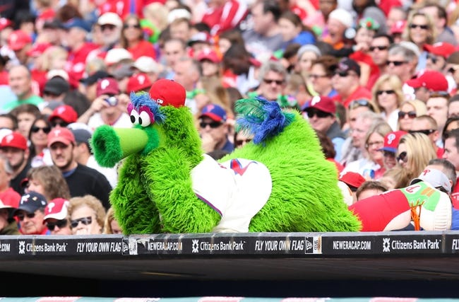 May 18, 2014; Philadelphia, PA, USA; The Philly Phanatic lays down and watches the action on top of the dugout in a game against the Cincinnati Reds at Citizens Bank Park. The Phillies won 8-3. Mandatory Credit: Bill Streicher-USA TODAY Sports