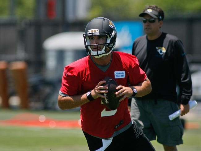 May 16, 2014; Jacksonville, FL, USA; Jacksonville Jaguars quarterback Blake Bortles (5) rolls out as offensive coordinator Jedd Fisch watches from behind during Rookie Minicamp at Florida Blue Health and Wellness Practice Fields. Mandatory Credit: Phil Sears-USA TODAY Sports