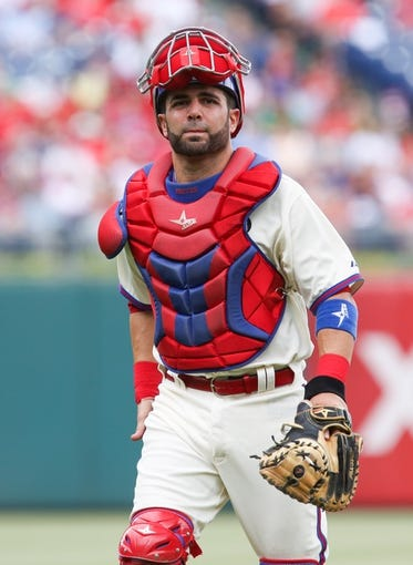 May 18, 2014; Philadelphia, PA, USA; Philadelphia Phillies catcher Wil Nieves (21) lifts his mask and walks back to the plate in a game against the Cincinnati Reds at Citizens Bank Park. The Phillies won 8-3. Mandatory Credit: Bill Streicher-USA TODAY Sports