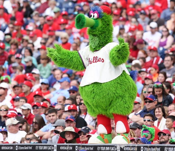 May 18, 2014; Philadelphia, PA, USA; The Philly Phanatic waves his arms on top of the dugout in a game against the Cincinnati Reds at Citizens Bank Park. The Phillies won 8-3. Mandatory Credit: Bill Streicher-USA TODAY Sports