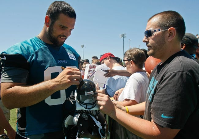 May 16, 2014; Jacksonville, FL, USA; Jacksonville Jaguars guard Brandon Linder (65) signs an autograph for a fan during Rookie Minicamp at Florida Blue Health and Wellness Practice Fields. Mandatory Credit: Phil Sears-USA TODAY Sports