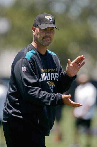 May 16, 2014; Jacksonville, FL, USA; Jacksonville Jaguars head coach Gus Bradley claps during Rookie Minicamp at Florida Blue Health and Wellness Practice Fields. Mandatory Credit: Phil Sears-USA TODAY Sports
