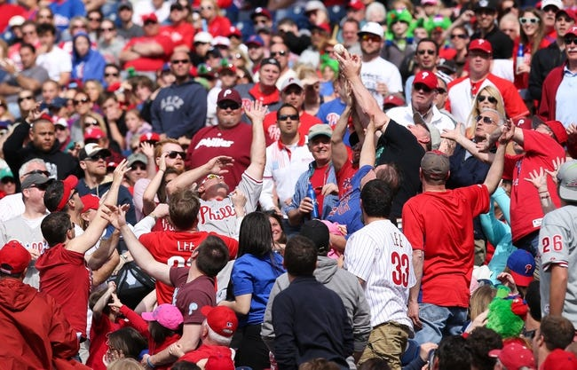 May 18, 2014; Philadelphia, PA, USA; Fans reach up as they attempt to catch a foul ball in a game between the Philadelphia Phillies and Cincinnati Reds at Citizens Bank Park. The Phillies won 8-3. Mandatory Credit: Bill Streicher-USA TODAY Sports