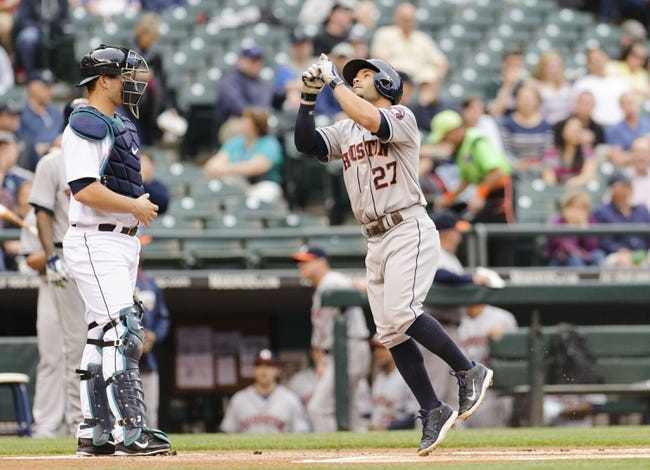 May 22, 2014; Seattle, WA, USA; Houston Astros second baseman Jose Altuve (27) crosses home plate after hitting a solo home run against the Seattle Mariners during the first inning at Safeco Field. Mandatory Credit: Steven Bisig-USA TODAY Sports