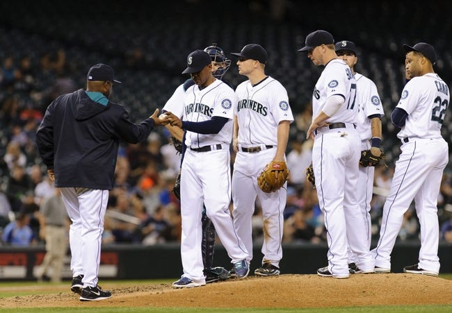 May 22, 2014; Seattle, WA, USA; Seattle Mariners manager Lloyd McClendon (23) pulls Seattle Mariners starting pitcher Roenis Elias (29) from the game during the sixth inning against the Houston Astros at Safeco Field. Mandatory Credit: Steven Bisig-USA TODAY Sports