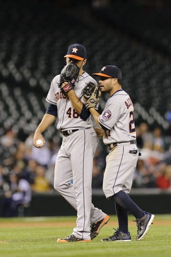 May 22, 2014; Seattle, WA, USA; Houston Astros starting pitcher Scott Feldman (46) and Houston Astros second baseman Jose Altuve (27) talk during the seventh inning against the Seattle Mariners at Safeco Field. Mandatory Credit: Steven Bisig-USA TODAY Sports