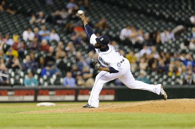 May 22, 2014; Seattle, WA, USA; Seattle Mariners relief pitcher Fernando Rodney (56) pitches to the Houston Astros during the ninth inning at Safeco Field. Seattle defeated Houston 3-1. Mandatory Credit: Steven Bisig-USA TODAY Sports