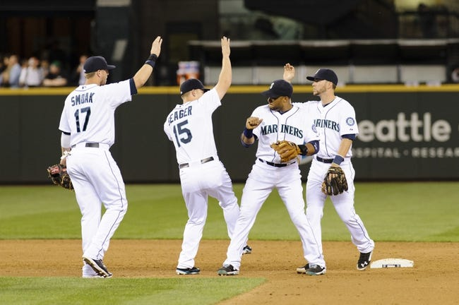 May 22, 2014; Seattle, WA, USA; The Seattle Mariners celebrate after defeating the Houston Astros at Safeco Field. Seattle defeated Houston 3-1. Mandatory Credit: Steven Bisig-USA TODAY Sports