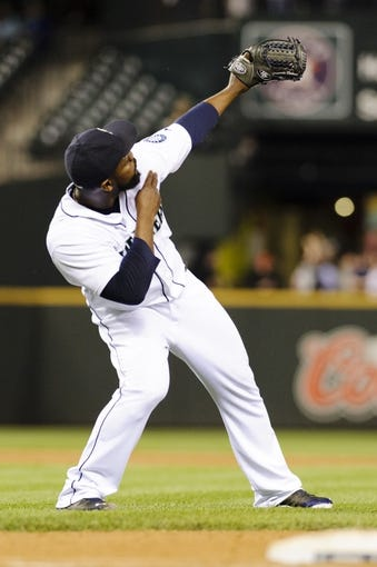 May 22, 2014; Seattle, WA, USA; Seattle Mariners relief pitcher Fernando Rodney (56) celebrates after getting the final out against the Houston Astros at Safeco Field. Seattle defeated Houston 3-1. Mandatory Credit: Steven Bisig-USA TODAY Sports