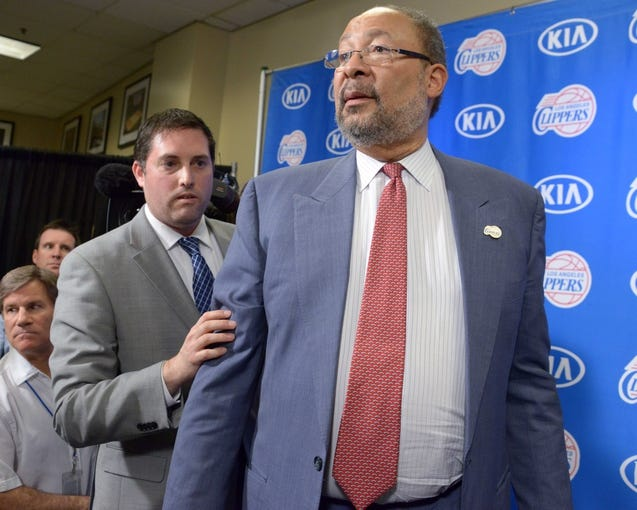 May 12, 2014; Los Angeles, CA, USA; Los Angeles Clippers vice president of communications Seth Burton (left) escorts Dick Parson out of press conference to introduce Parsons as interim chief executive officer at Staples Center. Mandatory Credit: Kirby Lee-USA TODAY Sports