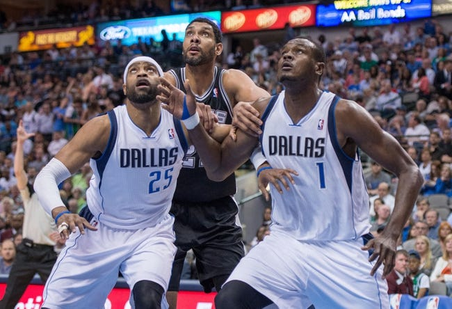 Apr 10, 2014; Dallas, TX, USA; Dallas Mavericks guard Vince Carter (25) and center Samuel Dalembert (1) and San Antonio Spurs forward Tim Duncan (21) during the game at the American Airlines Center. The Spurs defeated the Mavericks 109-100. Mandatory Credit: Jerome Miron-USA TODAY Sports