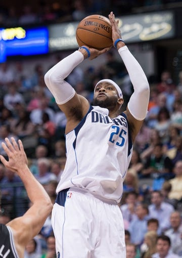 Apr 10, 2014; Dallas, TX, USA; Dallas Mavericks guard Vince Carter (25) during the game against the San Antonio Spurs at the American Airlines Center. The Spurs defeated the Mavericks 109-100. Mandatory Credit: Jerome Miron-USA TODAY Sports