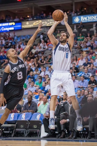 Apr 10, 2014; Dallas, TX, USA; San Antonio Spurs guard Patty Mills (8) and Dallas Mavericks guard Jose Calderon (8) during the game at the American Airlines Center. The Spurs defeated the Mavericks 109-100. Mandatory Credit: Jerome Miron-USA TODAY Sports