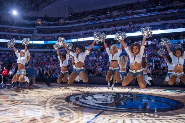 Apr 10, 2014; Dallas, TX, USA; The Dallas Mavericks dancers perform during the game between the Mavericks and the San Antonio Spurs at the American Airlines Center. The Spurs defeated the Mavericks 109-100. Mandatory Credit: Jerome Miron-USA TODAY Sports