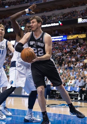 Apr 10, 2014; Dallas, TX, USA; San Antonio Spurs center Tiago Splitter (22) during the game against the Dallas Mavericks at the American Airlines Center. The Spurs defeated the Mavericks 109-100. Mandatory Credit: Jerome Miron-USA TODAY Sports