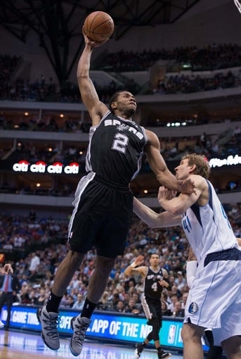 Apr 10, 2014; Dallas, TX, USA; San Antonio Spurs forward Kawhi Leonard (2) during the game against the Dallas Mavericks at the American Airlines Center. The Spurs defeated the Mavericks 109-100. Mandatory Credit: Jerome Miron-USA TODAY Sports
