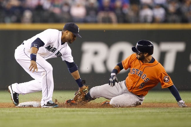 May 25, 2014; Seattle, WA, USA; Seattle Mariners second baseman Robinson Cano (22) tags out Houston Astros shortstop Marwin Gonzalez (9) on a steal attempt during the third inning at Safeco Field. Mandatory Credit: Joe Nicholson-USA TODAY Sports