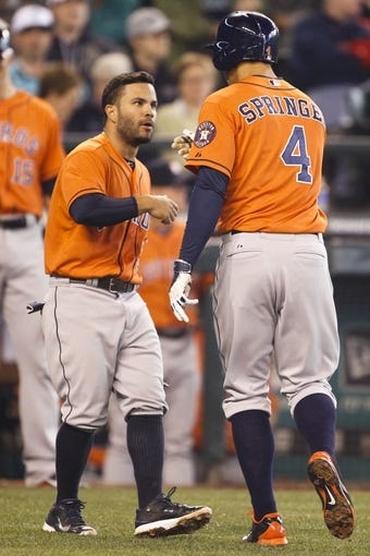 May 25, 2014; Seattle, WA, USA; Houston Astros second baseman Jose Altuve (27) greets Houston Astros right fielder George Springer (4) at home after scoring on a two-run homer by Springer during the sixth inning at Safeco Field. Mandatory Credit: Joe Nicholson-USA TODAY Sports