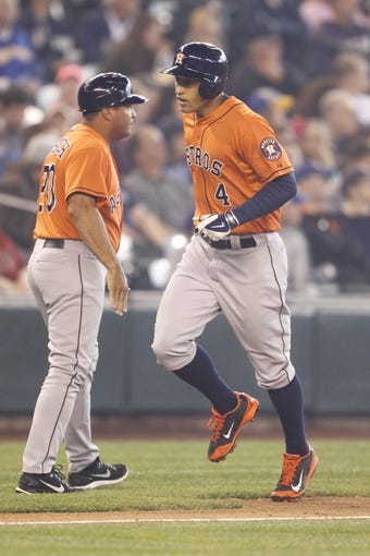 May 25, 2014; Seattle, WA, USA; Houston Astros right fielder George Springer (4) rounds the bases after hitting a two-run homer off of Seattle Mariners pitcher Hisashi Iwakuma (18) during the sixth inning at Safeco Field. Mandatory Credit: Joe Nicholson-USA TODAY Sports