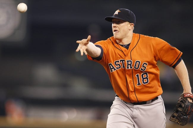 May 25, 2014; Seattle, WA, USA; Houston Astros first baseman Marc Krauss (18) assists on a putout against the Seattle Mariners during the sixth inning at Safeco Field. Mandatory Credit: Joe Nicholson-USA TODAY Sports