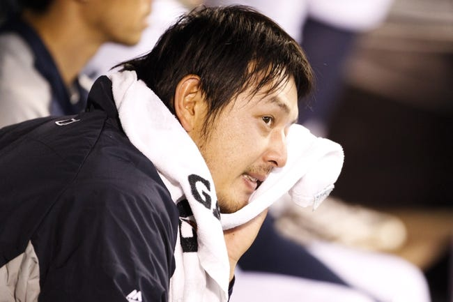 May 25, 2014; Seattle, WA, USA; Seattle Mariners pitcher Hisashi Iwakuma (18) sits in the dugout following the seventh inning against the Houston Astros at Safeco Field. Mandatory Credit: Joe Nicholson-USA TODAY Sports