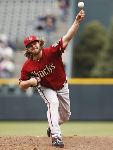 Apr 6, 2014; Denver, CO, USA; Arizona Diamondbacks starting pitcher Wade Miley (36) delivers a pitch during the first inning against the Colorado Rockies at Coors Field. Mandatory Credit: Chris Humphreys-USA TODAY Sports