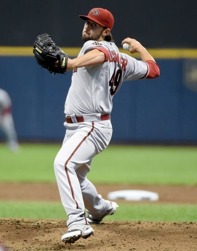 May 5, 2014; Milwaukee, WI, USA;  Arizona Diamondbacks pitcher Mike Bolsinger (49) pitches in the first inning against the Milwaukee Brewers at Miller Park. Mandatory Credit: Benny Sieu-USA TODAY Sports