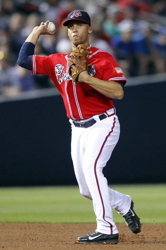 Apr 26, 2014; Atlanta, GA, USA; Atlanta Braves shortstop Andrelton Simmons (19) throws a runner out at first against the Cincinnati Reds in the fifth inning at Turner Field. Mandatory Credit: Brett Davis-USA TODAY Sports