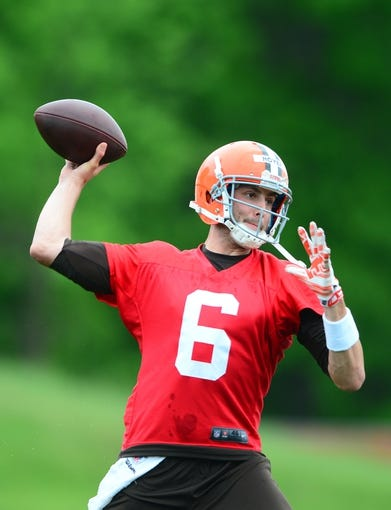 May 28, 2014; Berea, OH, USA; Cleveland Browns quarterback Brian Hoyer (6) throws a pass during organized team activities at Cleveland Browns training facility. Mandatory Credit: Andrew Weber-USA TODAY Sports