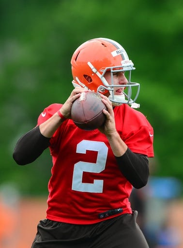 May 28, 2014; Berea, OH, USA; Cleveland Browns quarterback Johnny Manziel (2) looks to pass during organized team activities at Cleveland Browns training facility. Mandatory Credit: Andrew Weber-USA TODAY Sports
