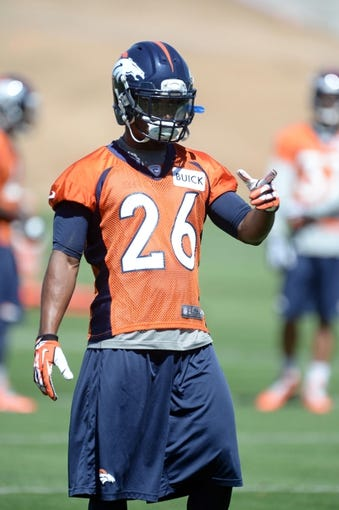May 28, 2013; Englewood, CO, USA; Denver Broncos free safety Rahim Moore (26) points during organized team activities at the Broncos training facility. Mandatory Credit: Ron Chenoy-USA TODAY Sports