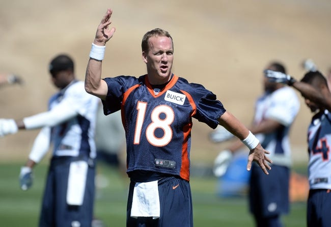 May 28, 2013; Englewood, CO, USA; Denver Broncos quarterback Peyton Manning (18) warms up before the start of organized team activities at the Broncos training facility. Mandatory Credit: Ron Chenoy-USA TODAY Sports