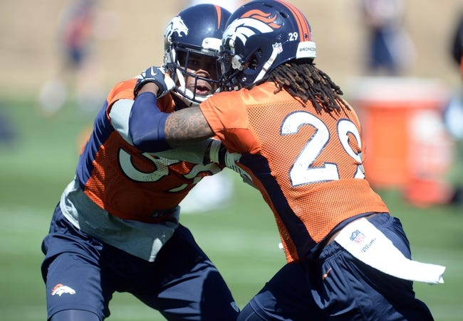 May 28, 2013; Englewood, CO, USA; Denver Broncos cornerback Louis Young (39) and cornerback Bradley Roby (29) battle for position during organized team activities at the Broncos training facility. Mandatory Credit: Ron Chenoy-USA TODAY Sports