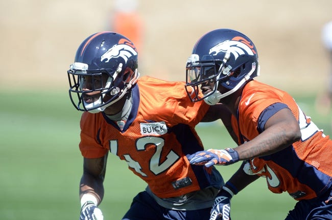 May 28, 2013; Englewood, CO, USA; Denver Broncos cornerback Jordan Sullen (42) and cornerback Jerome Murphy (45) battle for position during organized team activities at the Broncos training facility. Mandatory Credit: Ron Chenoy-USA TODAY Sports