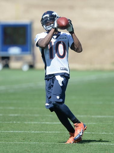 May 28, 2013; Englewood, CO, USA; Denver Broncos wide receiver Emmanuel Sanders (10) catches a pass during organized team activities at the Broncos training facility. Mandatory Credit: Ron Chenoy-USA TODAY Sports